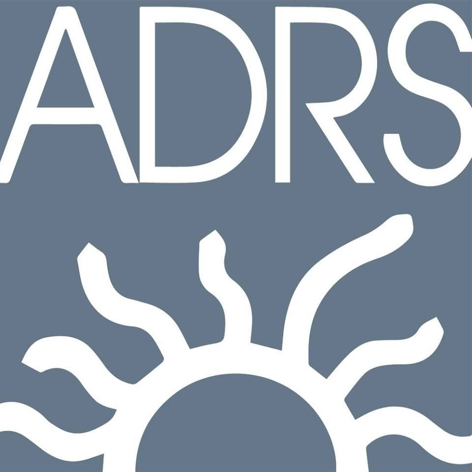 ADRS logo, ADRS in white lettering with an outline of the sun in white on a blue background