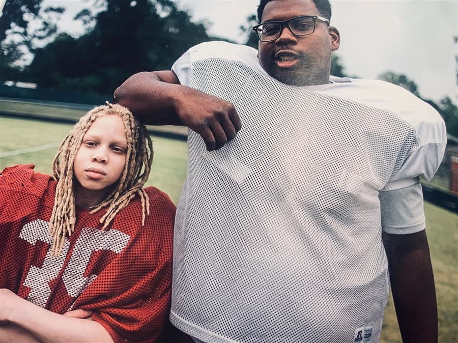 Photo of Daymion Winfrey and A.J. Simon Standing on the Football Field