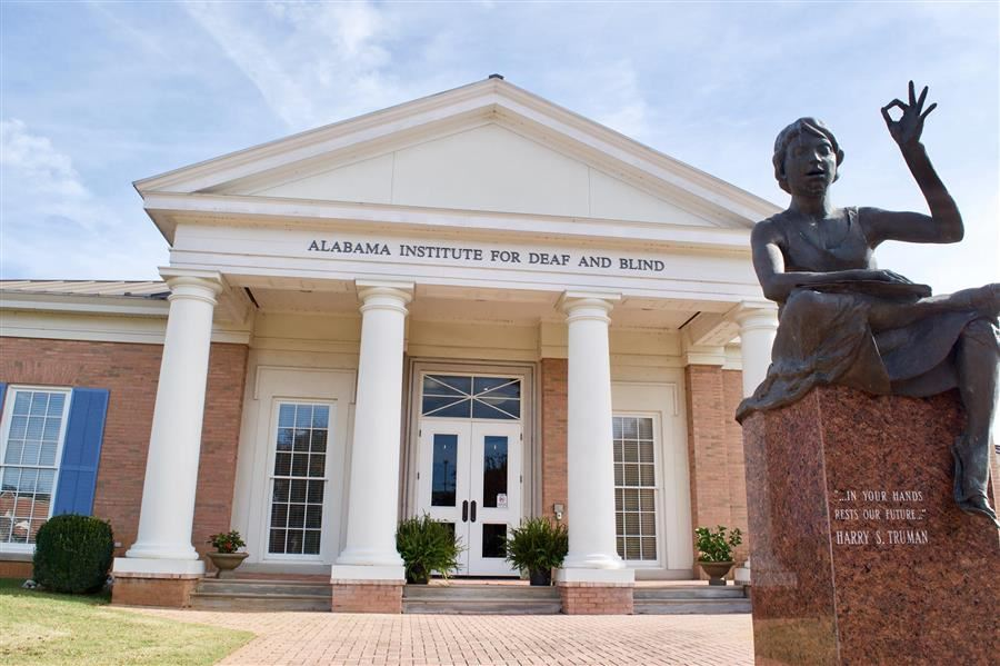front of AIDB Shoals Regional Center with Hellen Keller Statue